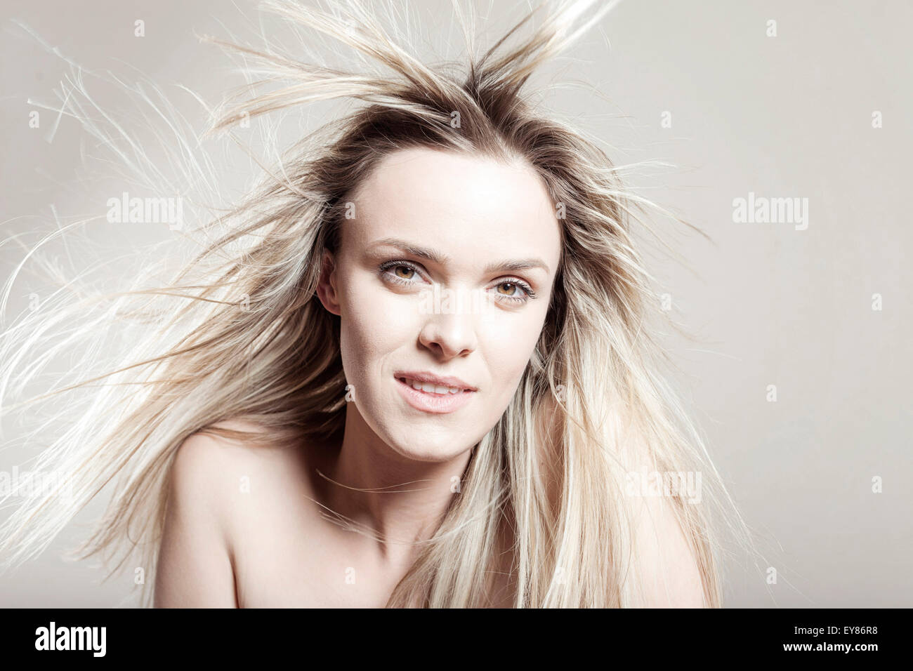 Young woman with tousled hair - Stock Image