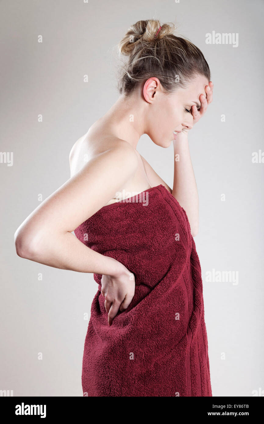 Young woman wrapped in towel - Stock Image