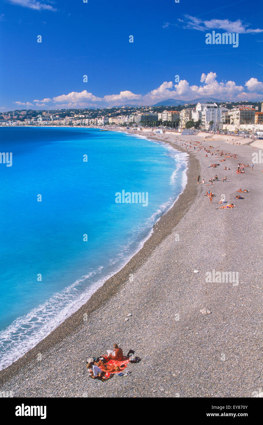 Blue Mediterranean Sea and white beaches of Nice on French Riviera - Stock Image