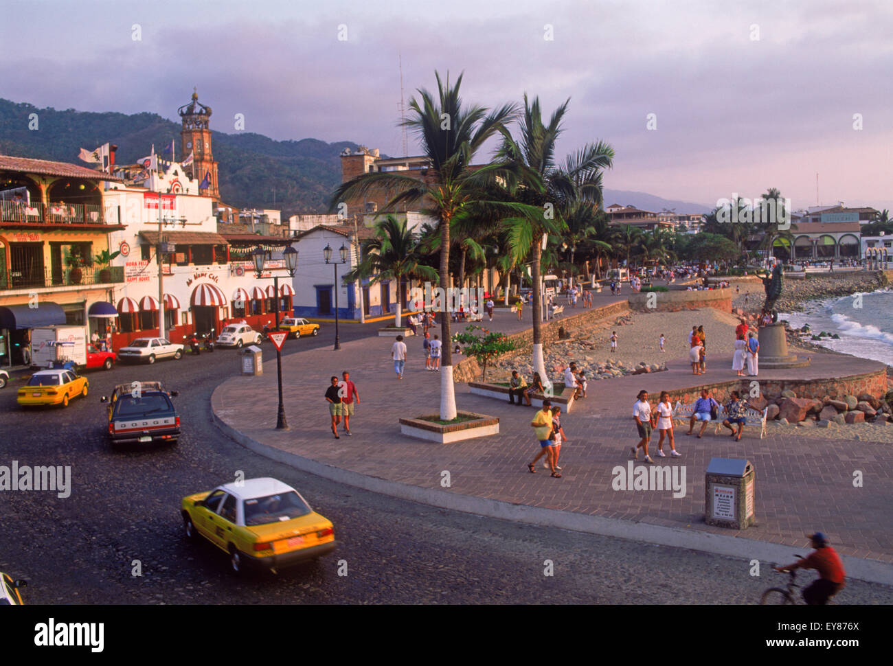 Guadalupe Church bell tower and street sidewalk along beach front road in Puerto Vallarta, Mexico - Stock Image