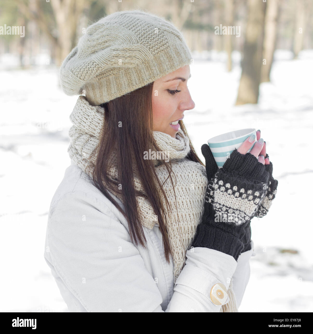 dd286e655 Winter Portrait of Lovely Female Enjoying drinking cup of hot tea outdoor.Beautiful  woman relaxing