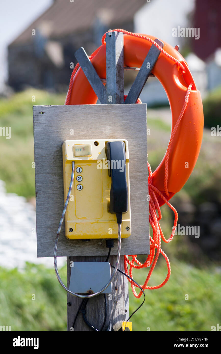 Only digits 1, 2 and 3 on phone with lifebuoy at Abereiddy, Pembrokeshire Coast National Park, Wales in May - Stock Image