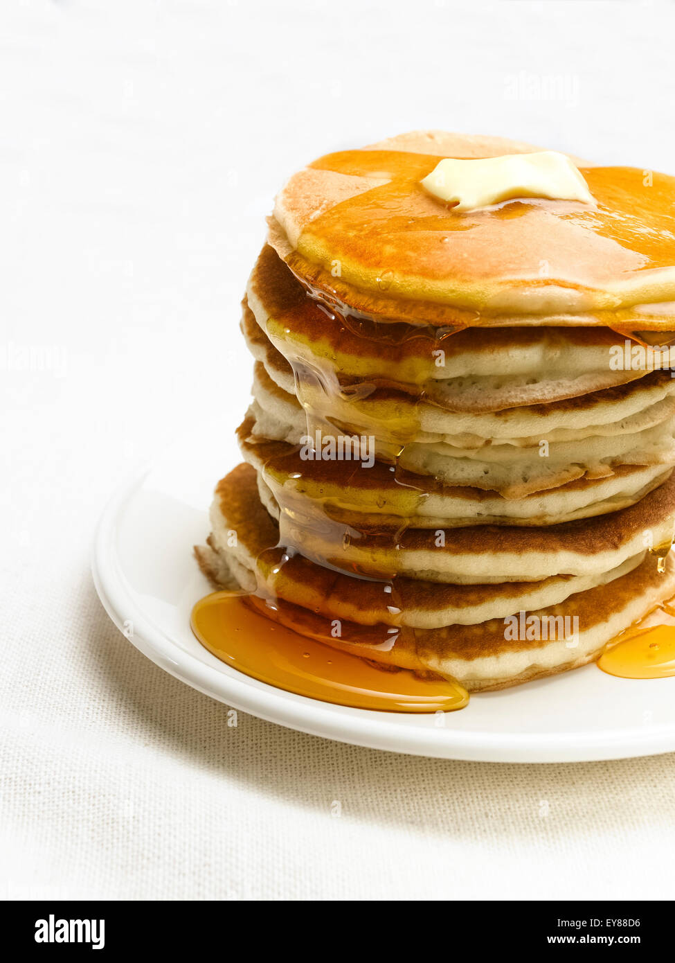 Table with Pancakes in a stack with syrup and butter - Stock Image