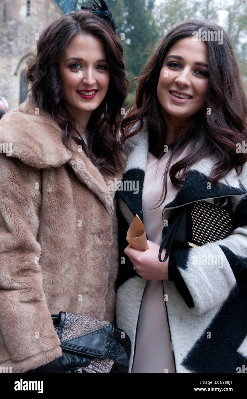 Two women with long dark hair smiling - Stock Image