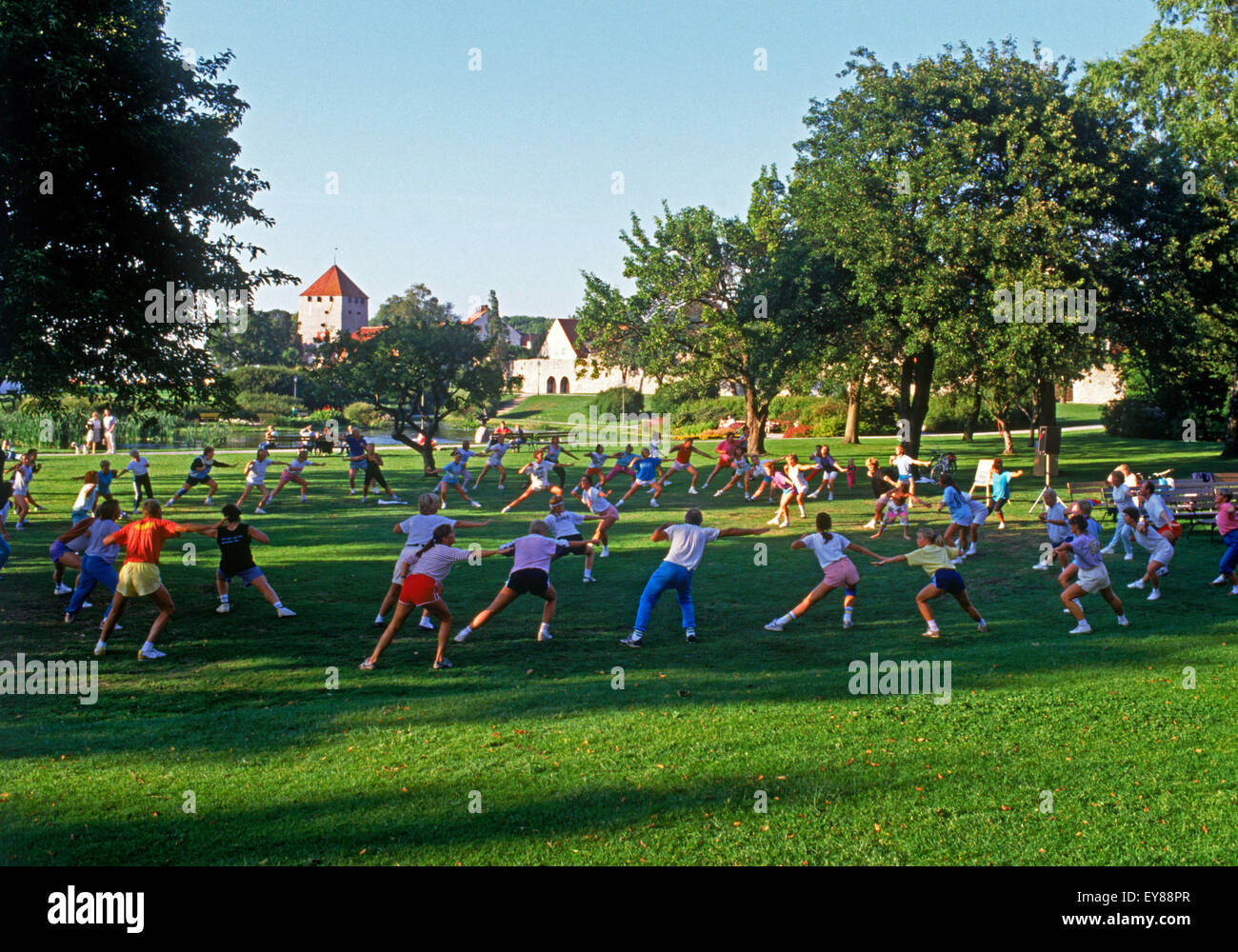 Outdoor exercise and aerobic classes in town of Visby on Swedish Island of Gotland, a place filled with Medieval - Stock Image