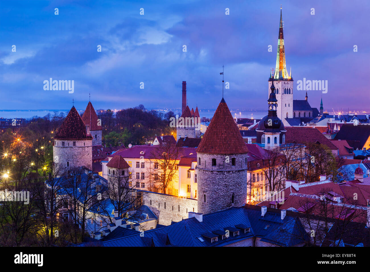 Aerial view of Tallinn Medieval Old Town illuminated in night, Estonia - Stock Image