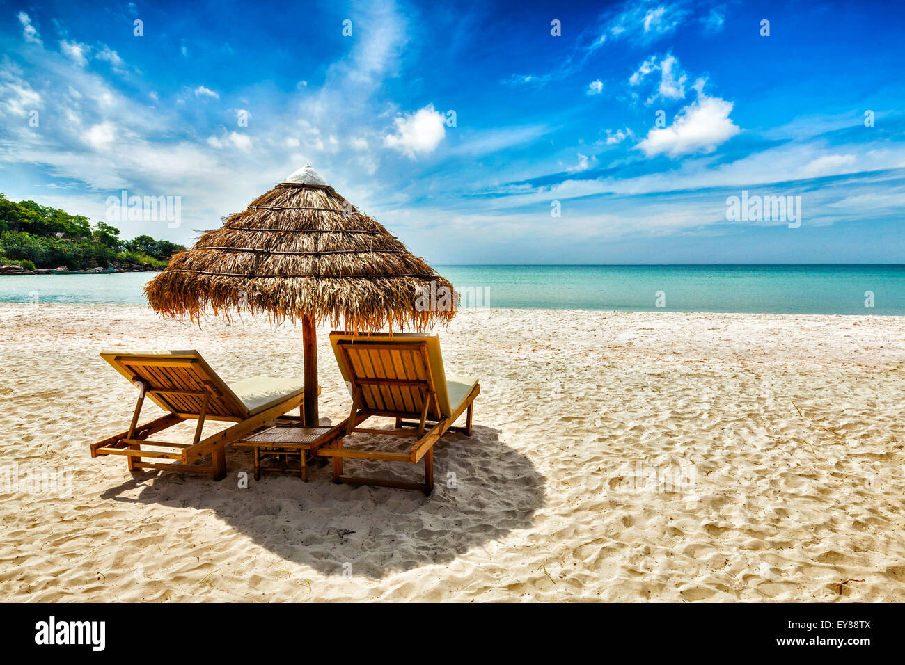 Vacation Holidays Background Wallpaper   Two Beach Lounge Chairs Under Tent  On Beach. Sihanoukville, Cambodia
