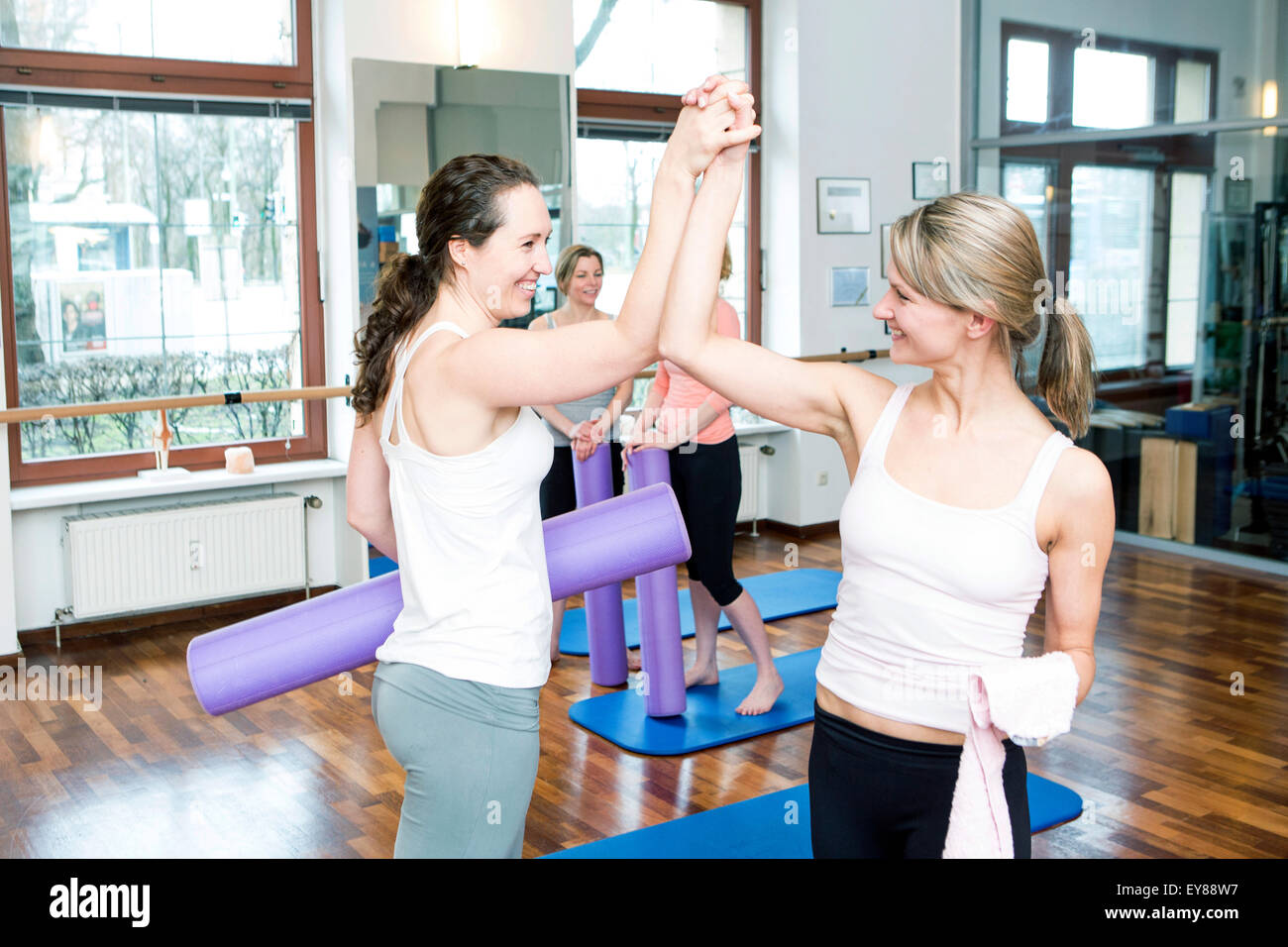 Women take a break on Pilates class - Stock Image