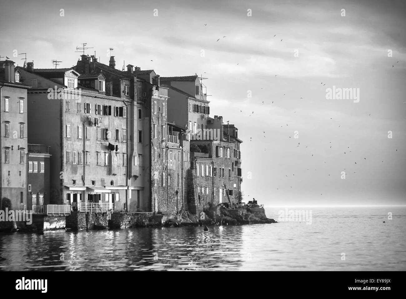A view of the old city core buildings at sunset in Rovinj, Croatia. - Stock Image