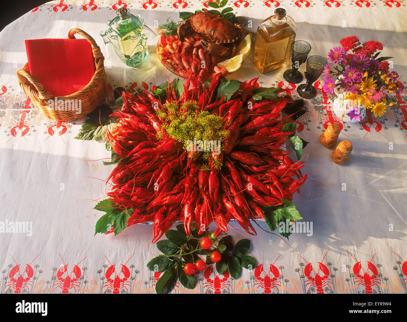 Table setting with plates of fresh crayfish and bread in Sweden - Stock Image