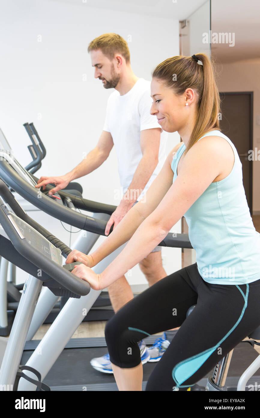 Fitness training on bikes - Stock Image