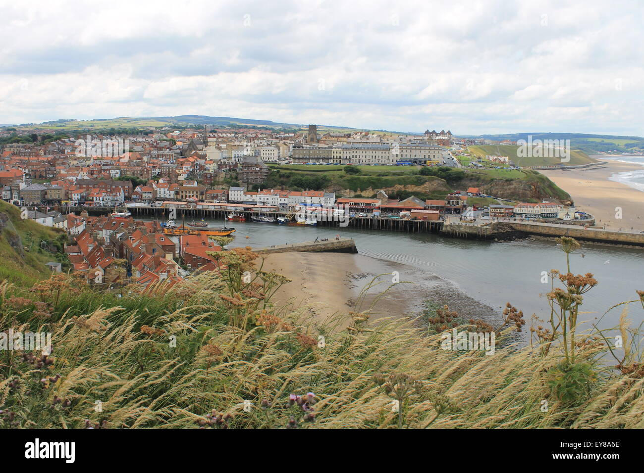 Whitby: looking north-west over the town from the Church of Saint Mary across the River Esk to the North York Moors - Stock Image