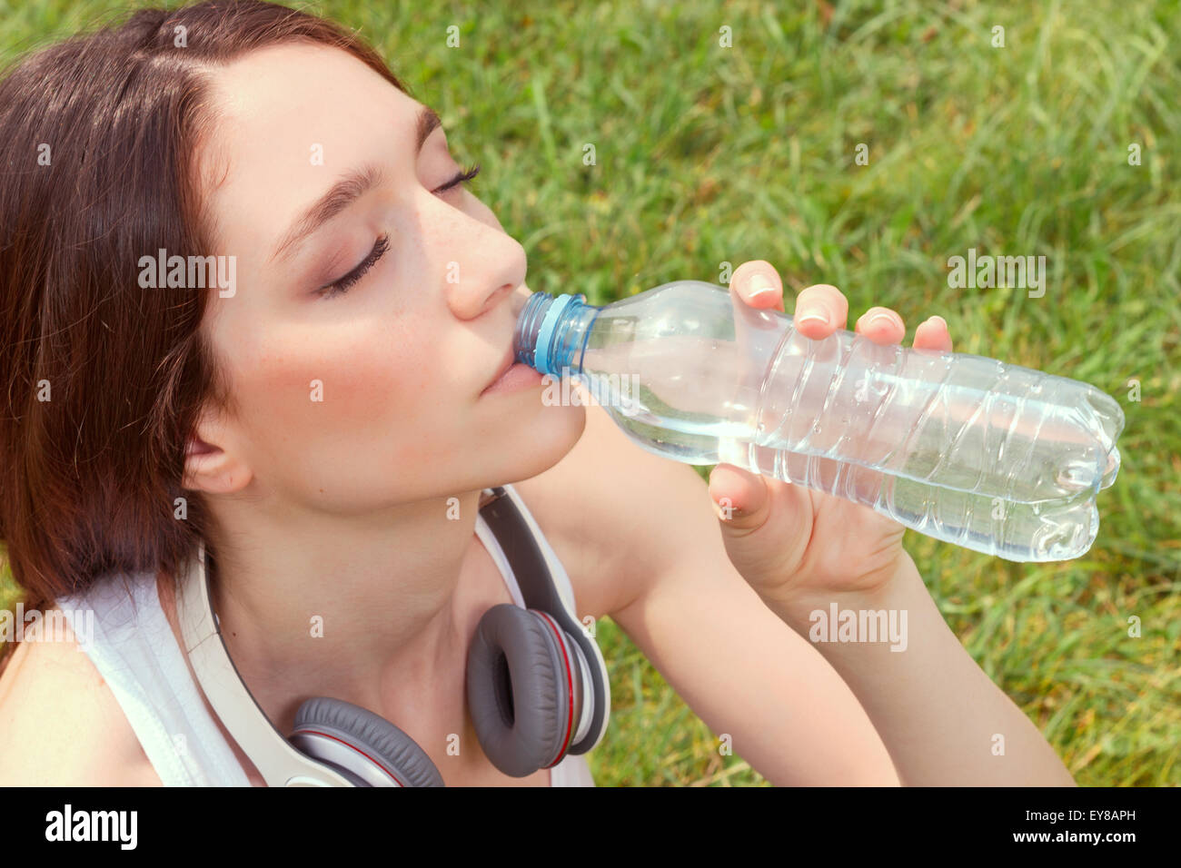Nice young girl drinking water - Stock Image
