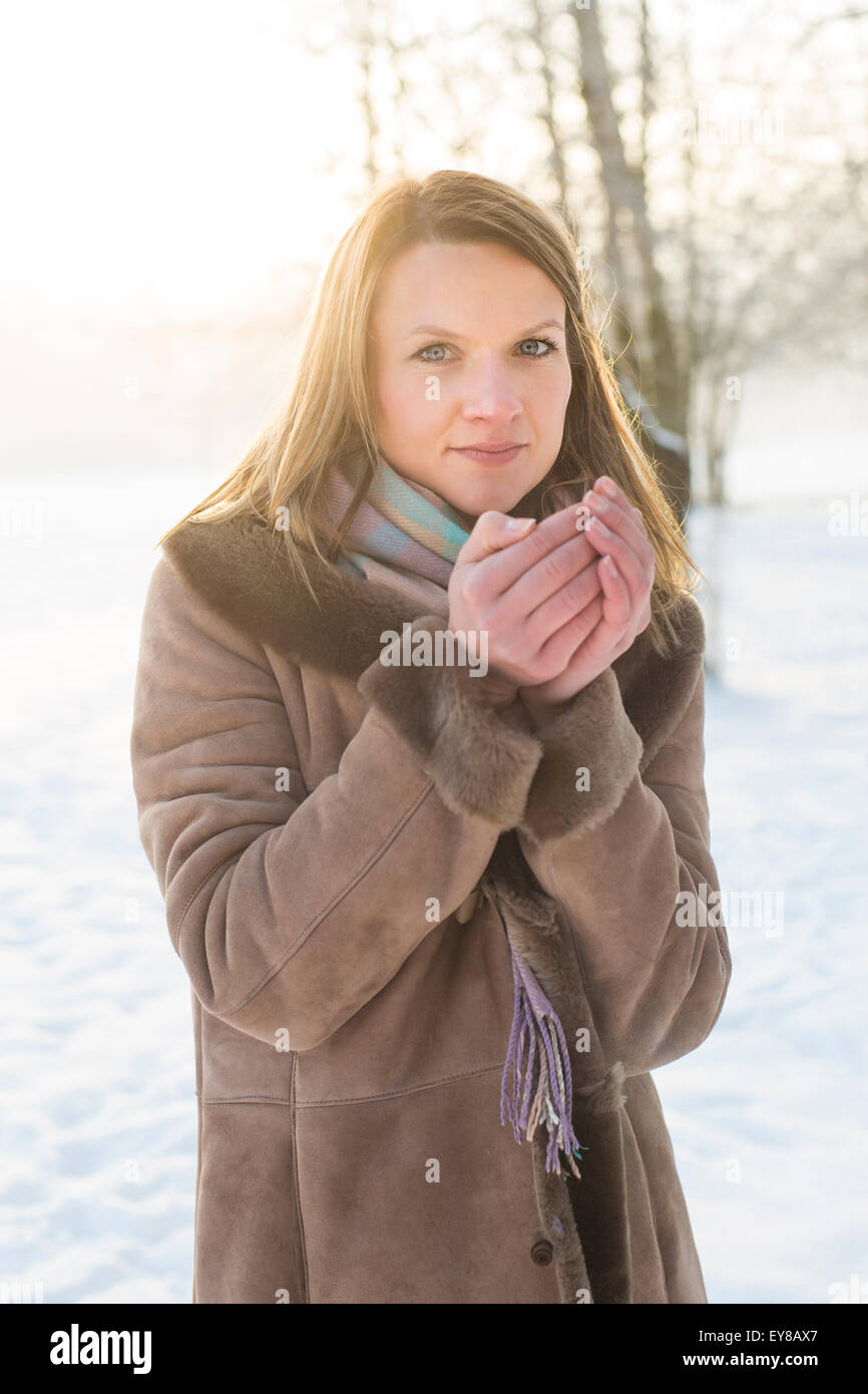 Young woman in warm clothing in winter - Stock Image
