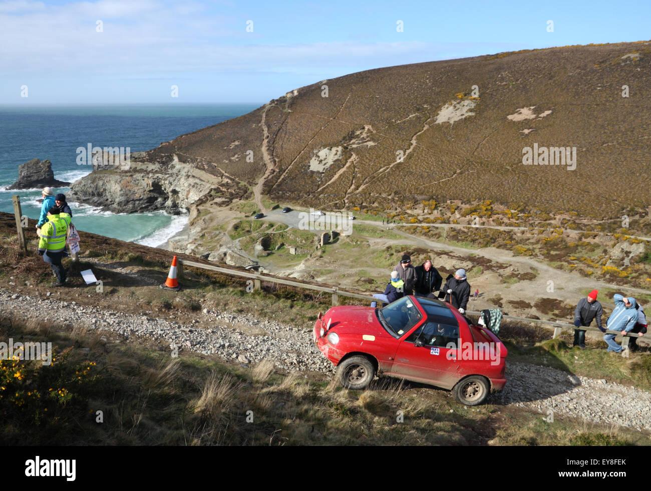 A Red Suzuki X 90 Car Takes Part In A Hill Climb Event At A Clifftop