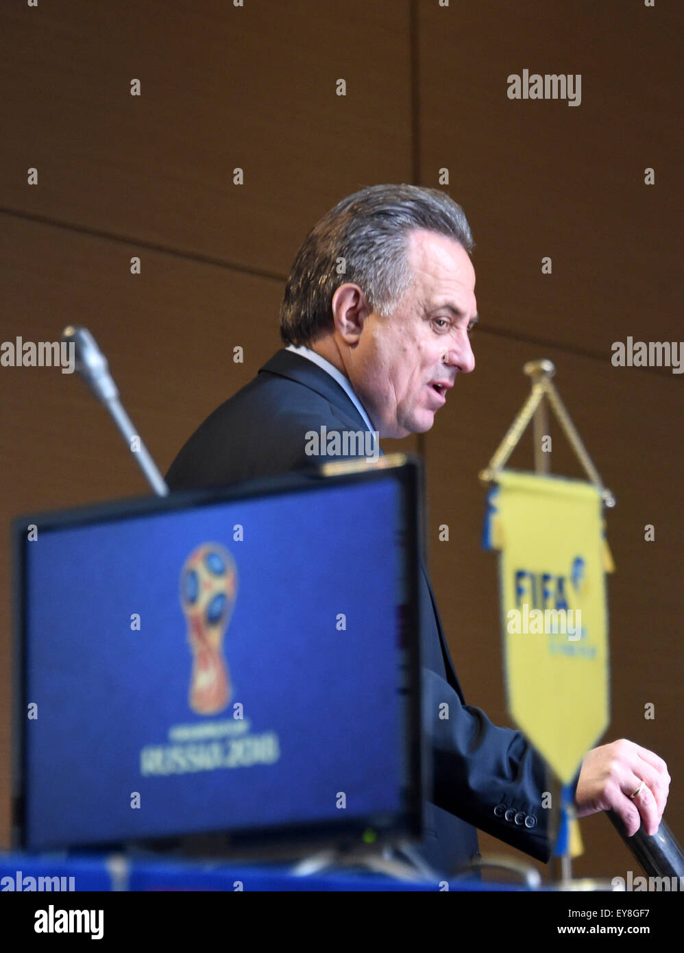 St. Petersburg, Russia. 24th July, 2015. Russian Sport Minister Vitaly Mutko stands on stage after a FIFA news conference - Stock Image
