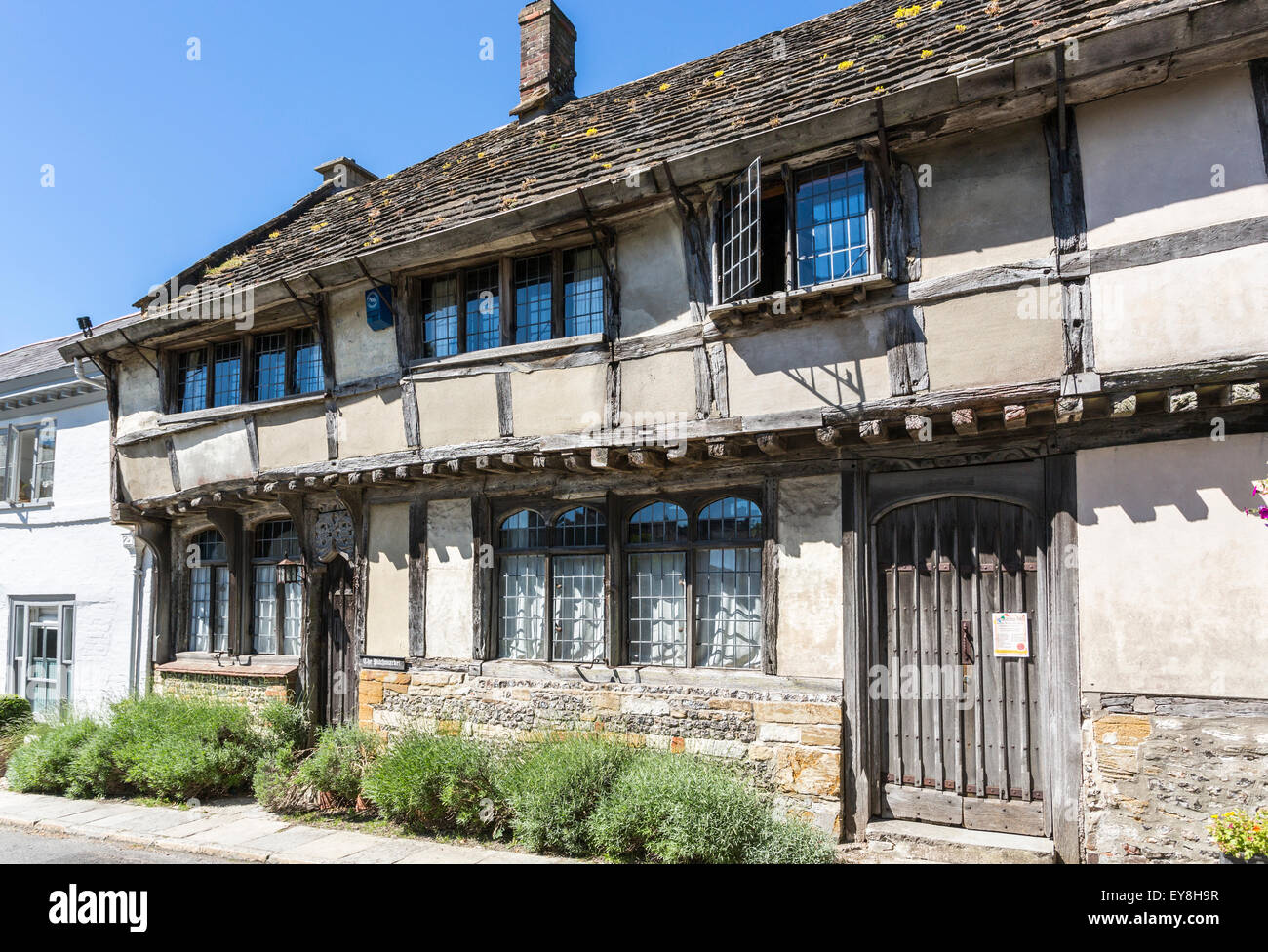 Old traditional timbered cottages, Cerne Abbas, Dorset, south-west England, with wooden doors and a slate tiled - Stock Image