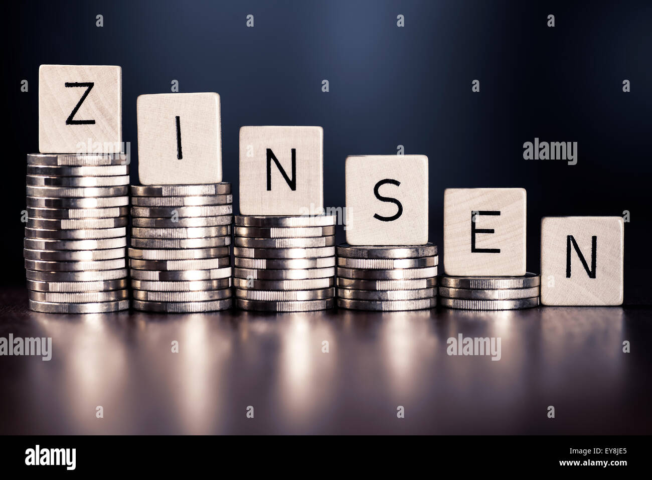 Stack of coins and the word interest. - Stock Image