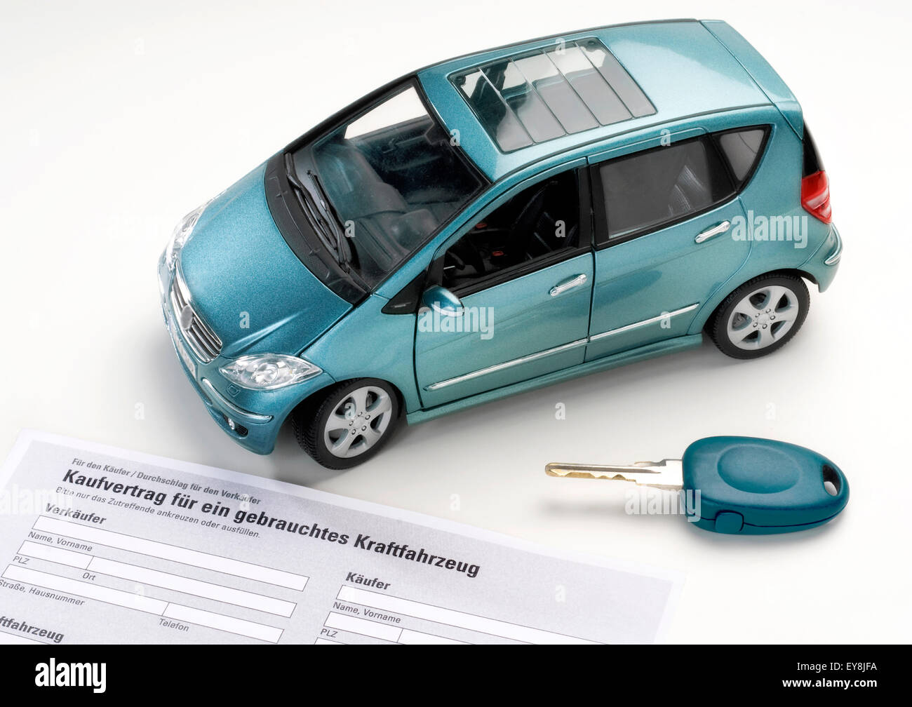 car with key and purchase agreement for a used vehicle stock photo
