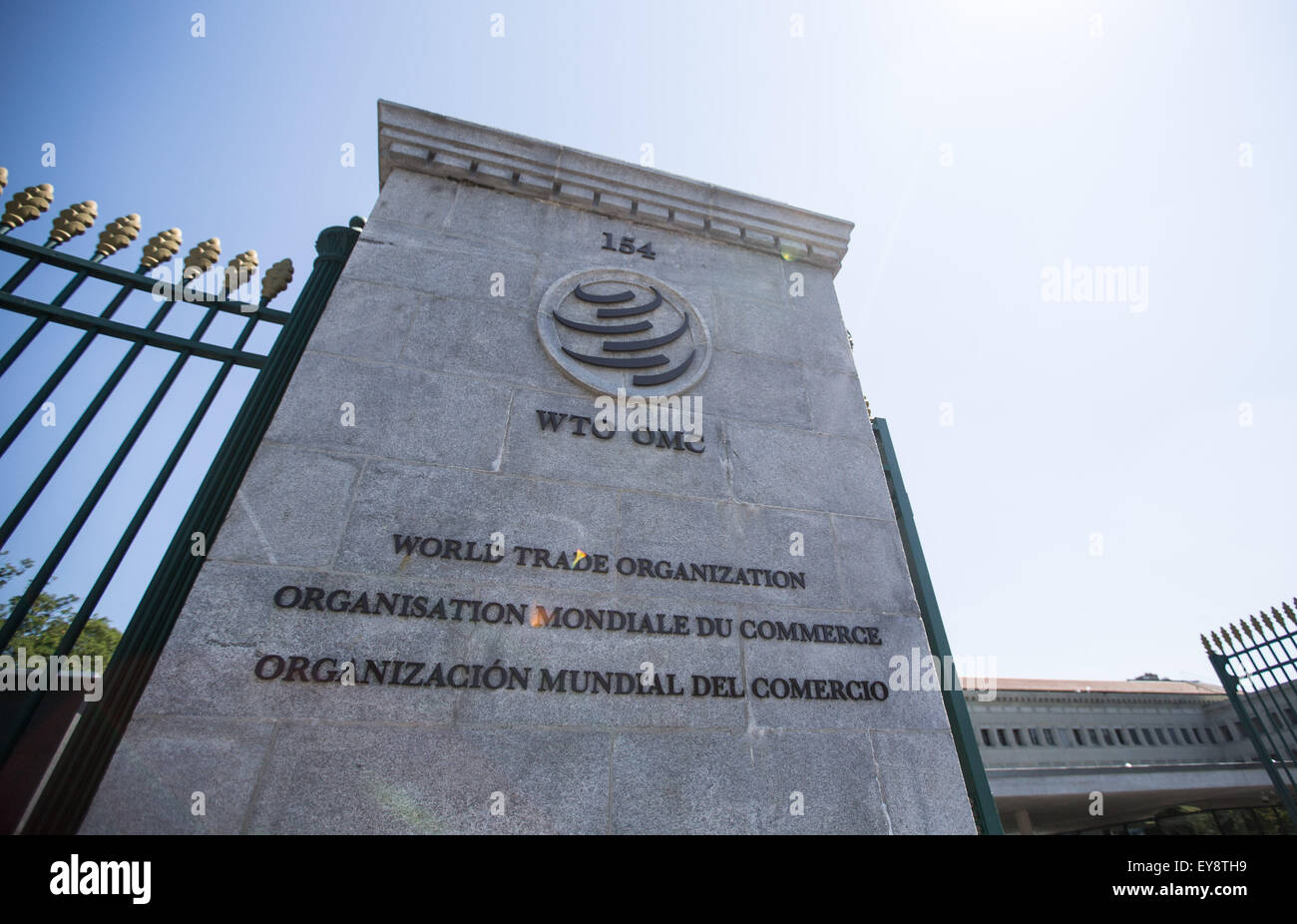 Geneva, Switzerland. 24th July, 2015. The World Trade Organization (WTO) logo is seen at the entrance of the WTO Stock Photo