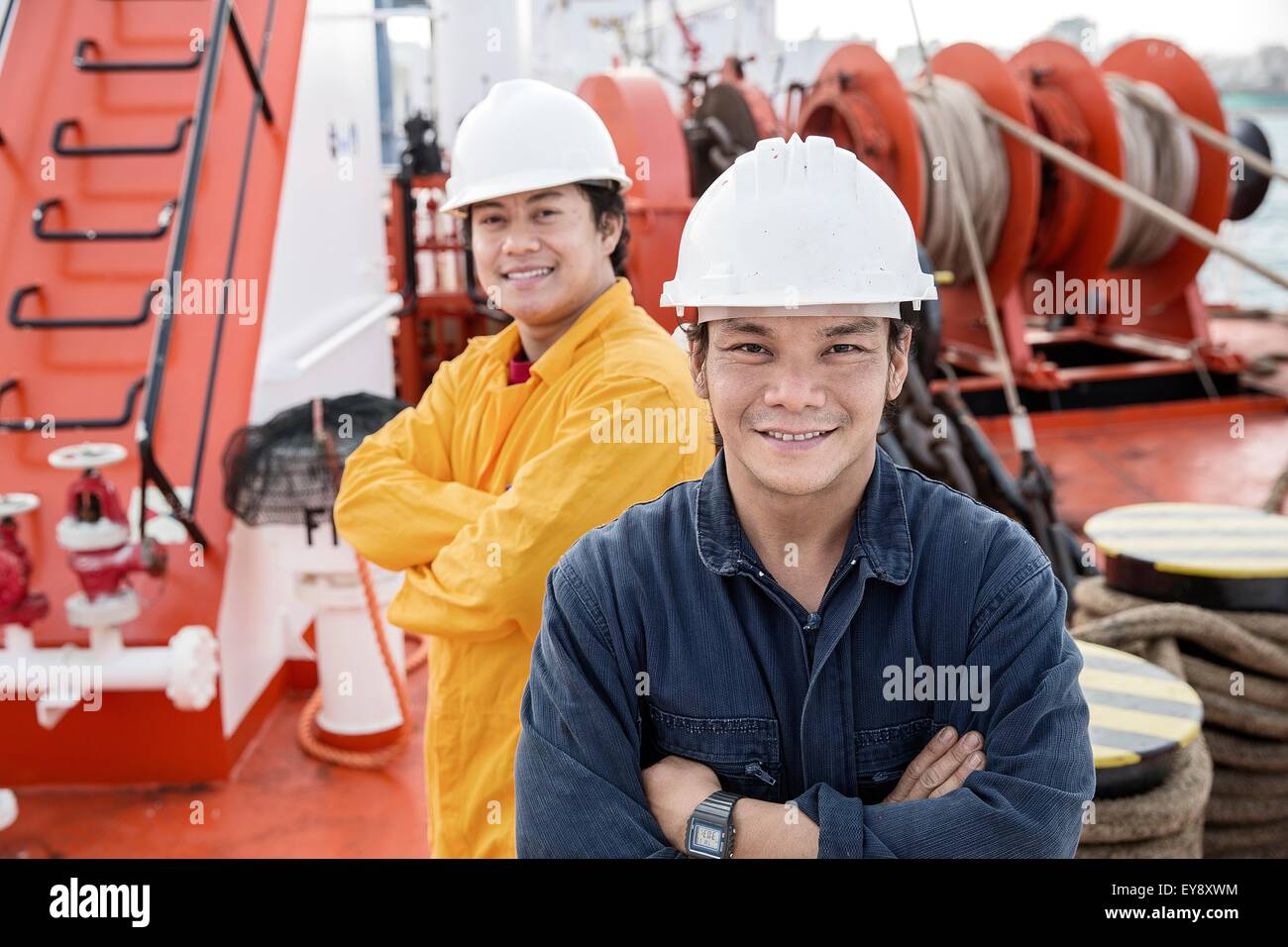 Portrait of workers on oil tanker - Stock Image