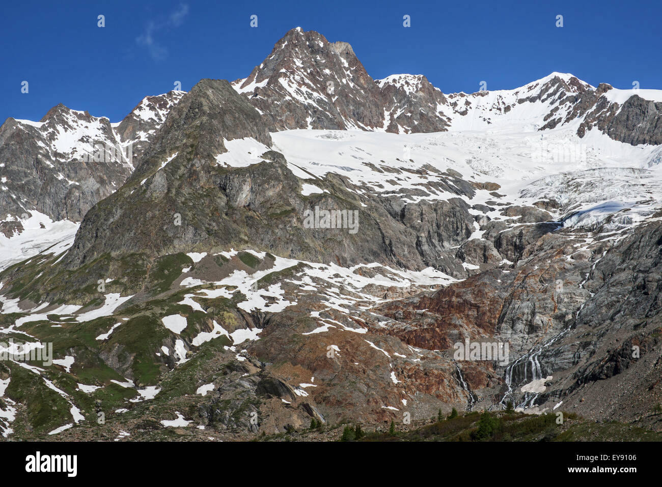 Retreating glacier on the Aiguille des Glaciers in the Mont Blanc massif in Val Veny in the Italian Alps, Italy Stock Photo