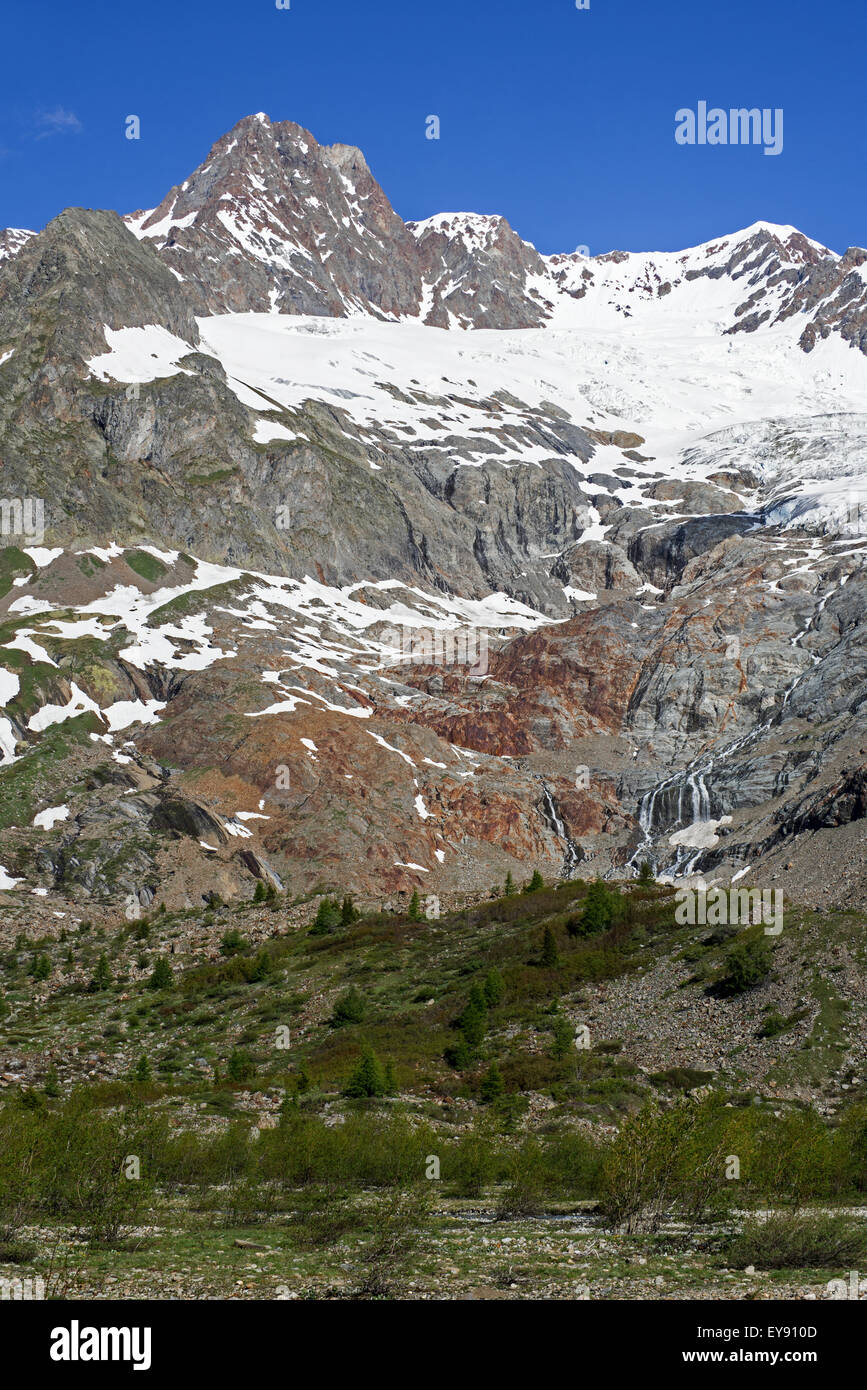 Retreating glacier on the Aiguille des Glaciers in the Mont Blanc massif in Val Veny in the Italian Alps, Italy - Stock Image
