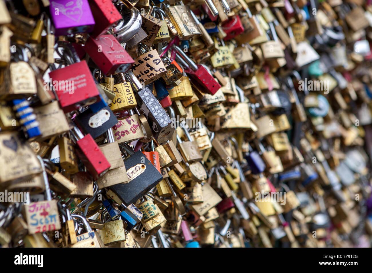 Love locks on a bridge in Paris. - Stock Image