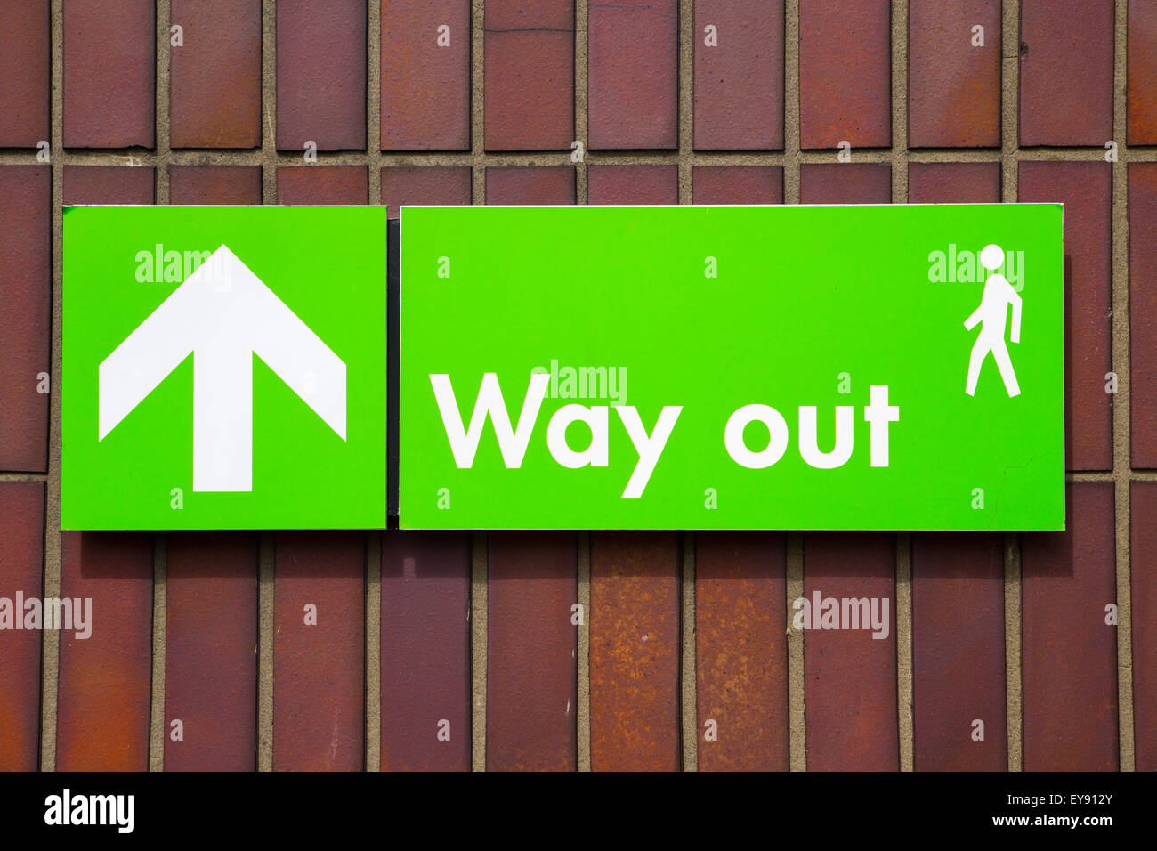 Way out sign with white writing and green background - Stock Image