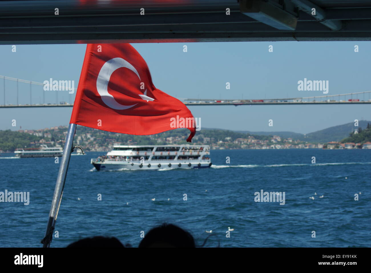 ferry ride Istanbul Turkish flag - Stock Image