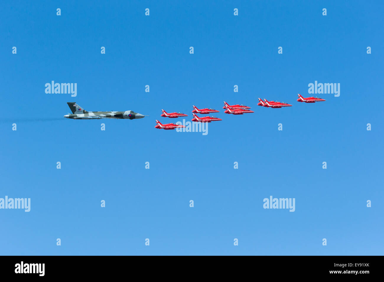 Avro 698 Vulcan B.2 XH558 takes part in its final RIAT fly past accompanied by the RAF Red Arrows with smoke on. - Stock Image