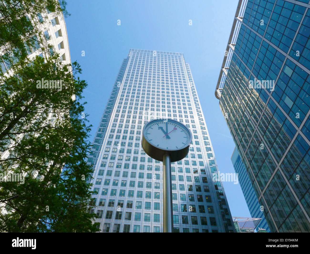 one of the six public clocks in front of the famous business office block One Canada Square in Canary Wharf, London - Stock Image