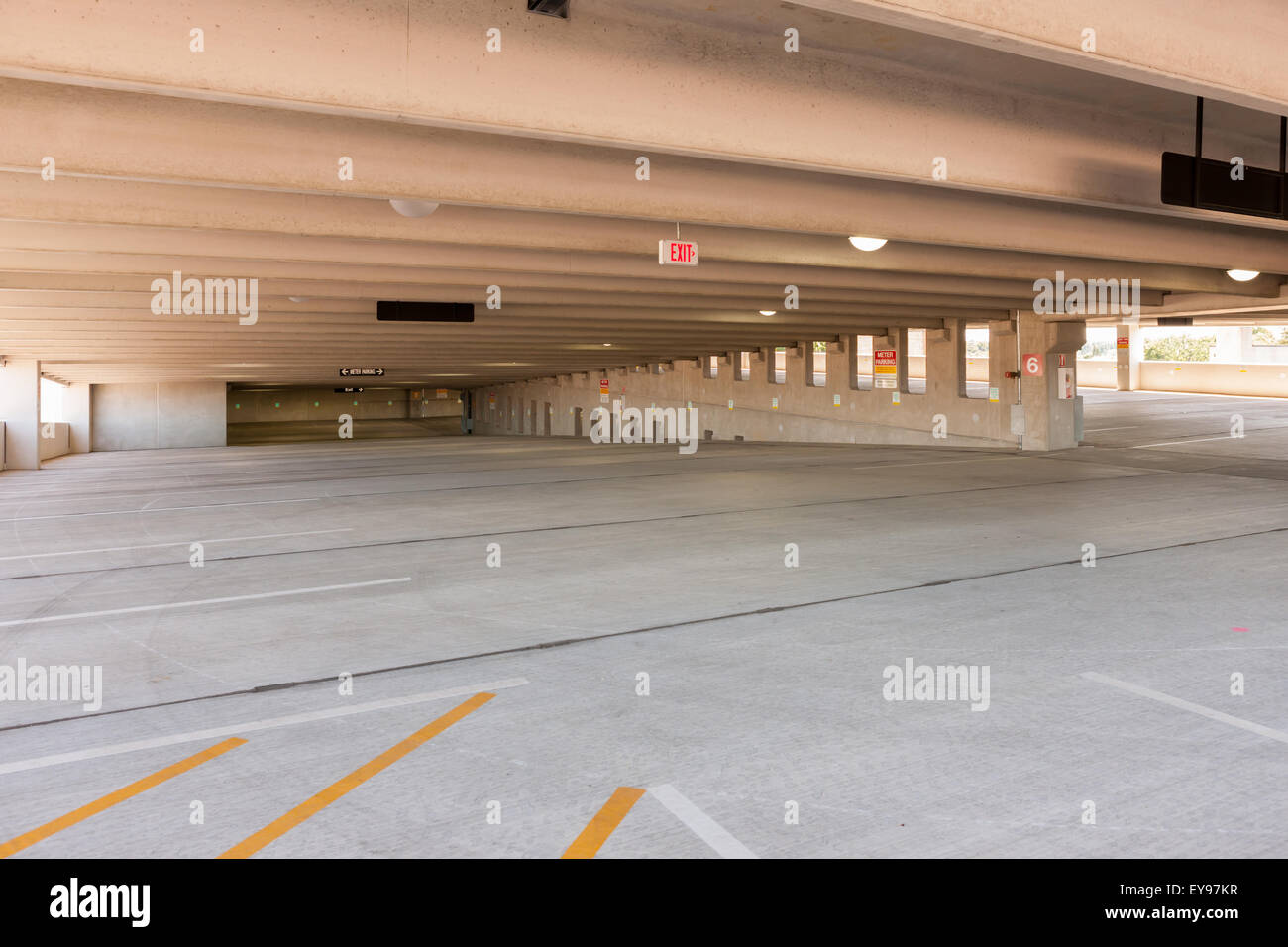 An empty parking level and spaces in the Lyon Place municipal parking garage in White Plains, New York. - Stock Image