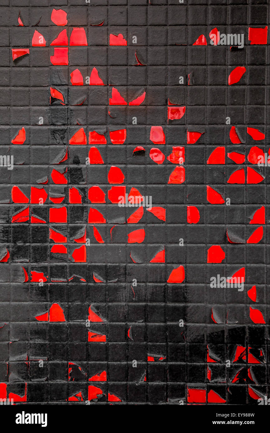 Grungy Red And Black Tile And Peeling Paint Wall Stock