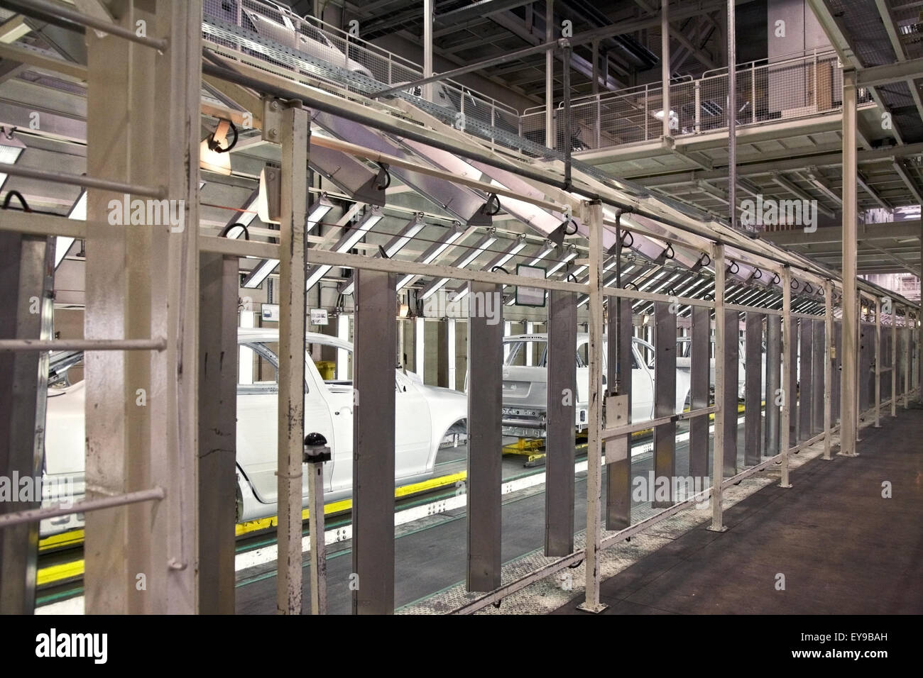 cars in a row at car plant - Stock Image