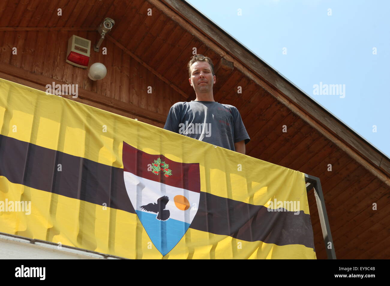 Kenneth Lillieholm, Grounds Operation Manager of LSA (Liberland Settlement Association) on the balcony of one of - Stock Image