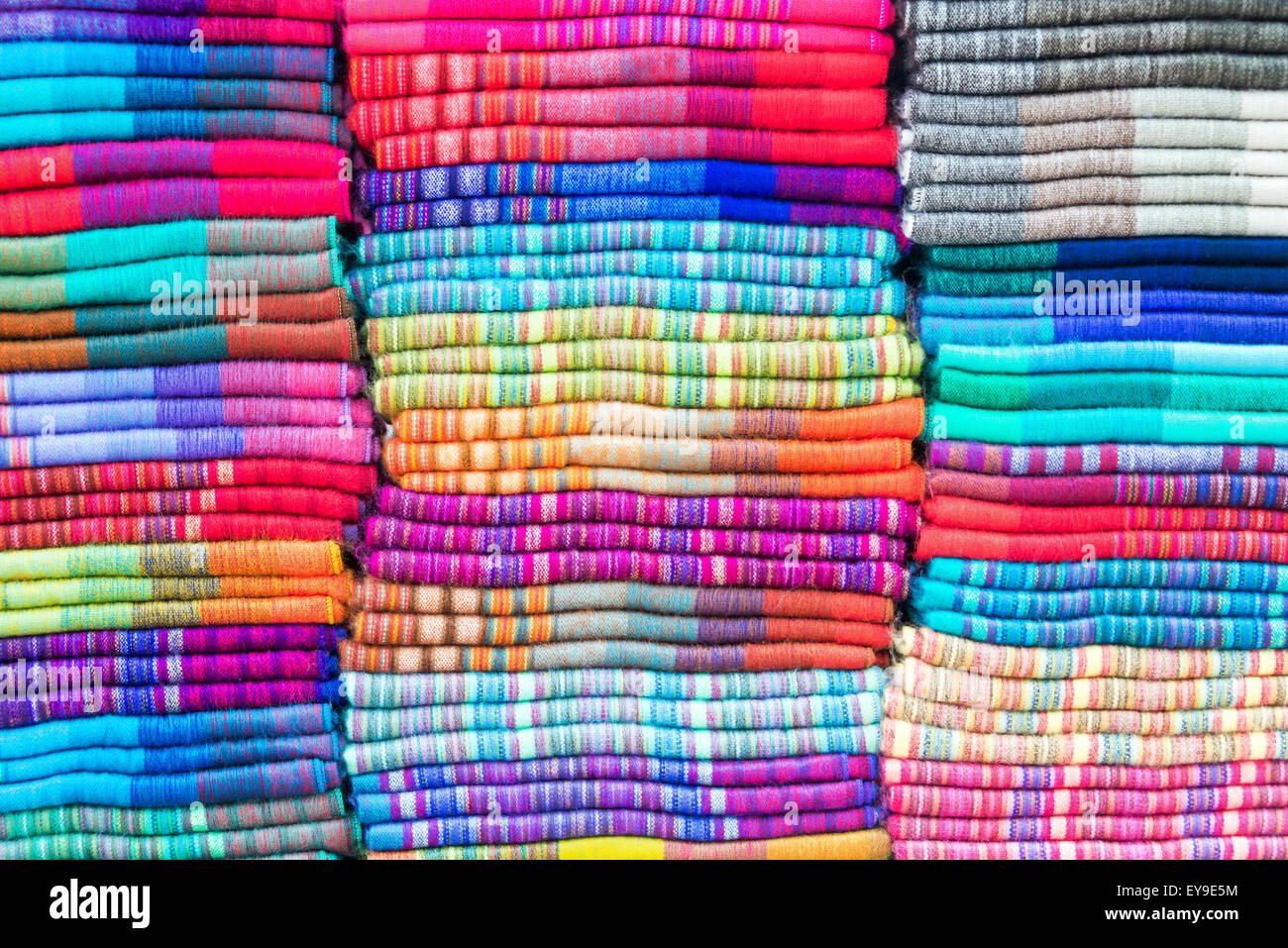 Soft colorful blankets made out of alpaca wool in the famed market of Otavalo, Ecuador - Stock Image
