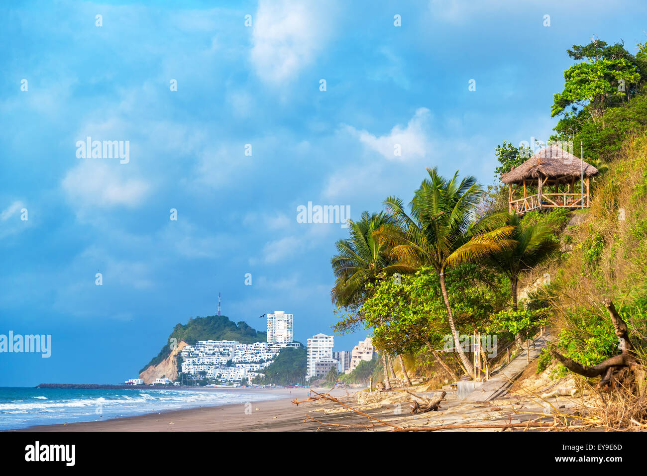 Beach in Same, Ecuador with a resort visible in the background - Stock Image