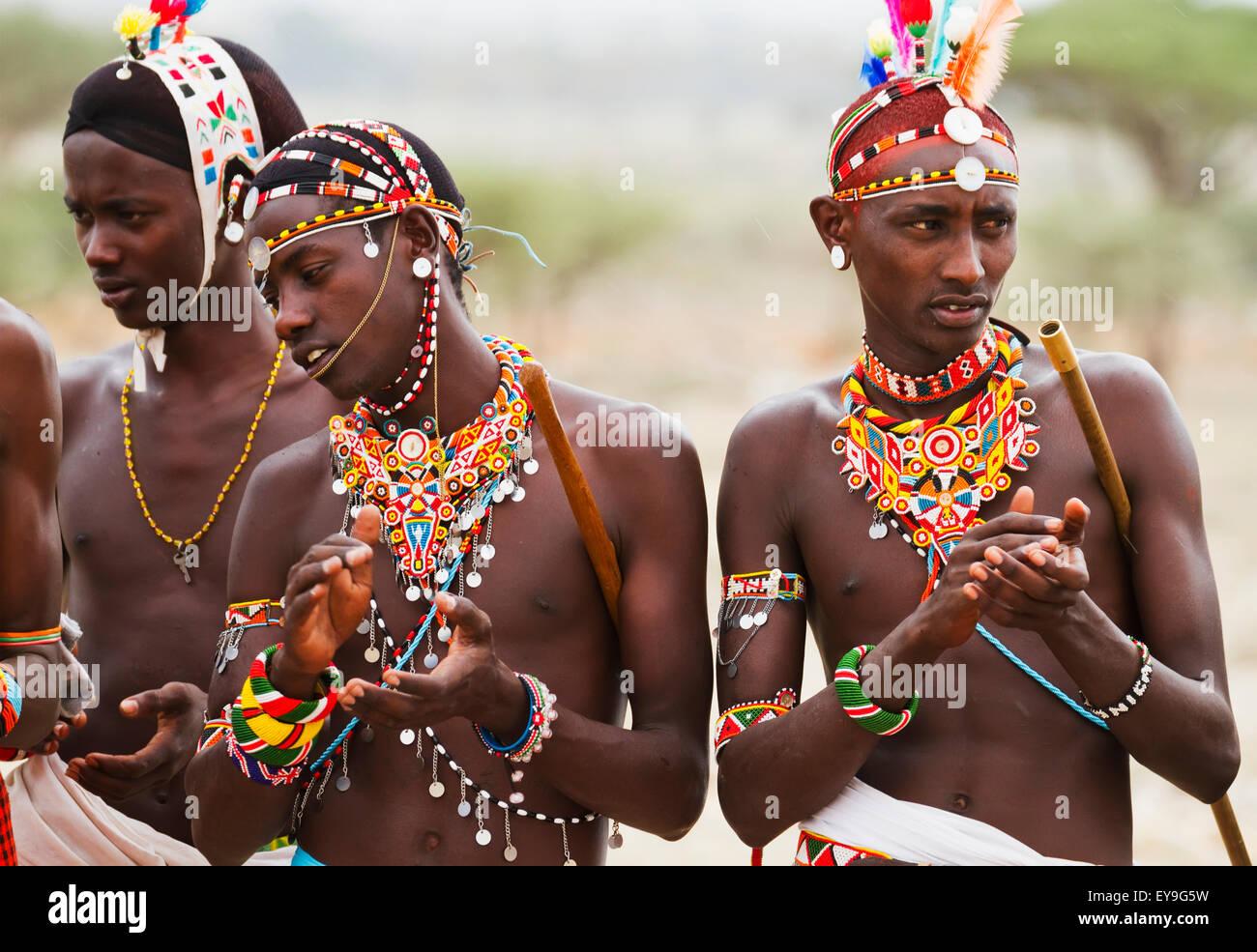 Samburu men singing and dancing, Samburu County; Kenya - Stock Image