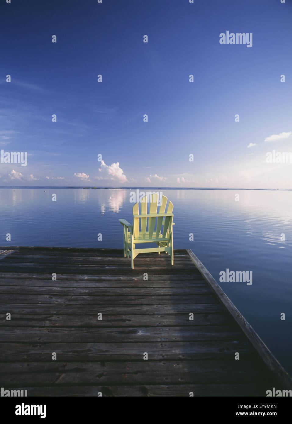 Chair On End Of Pier At Dawn Stock Photo