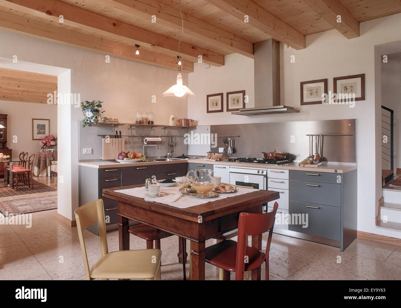 foreground of table laid in the rustic kitchen with marble floor and wood ceiling Stock Photo
