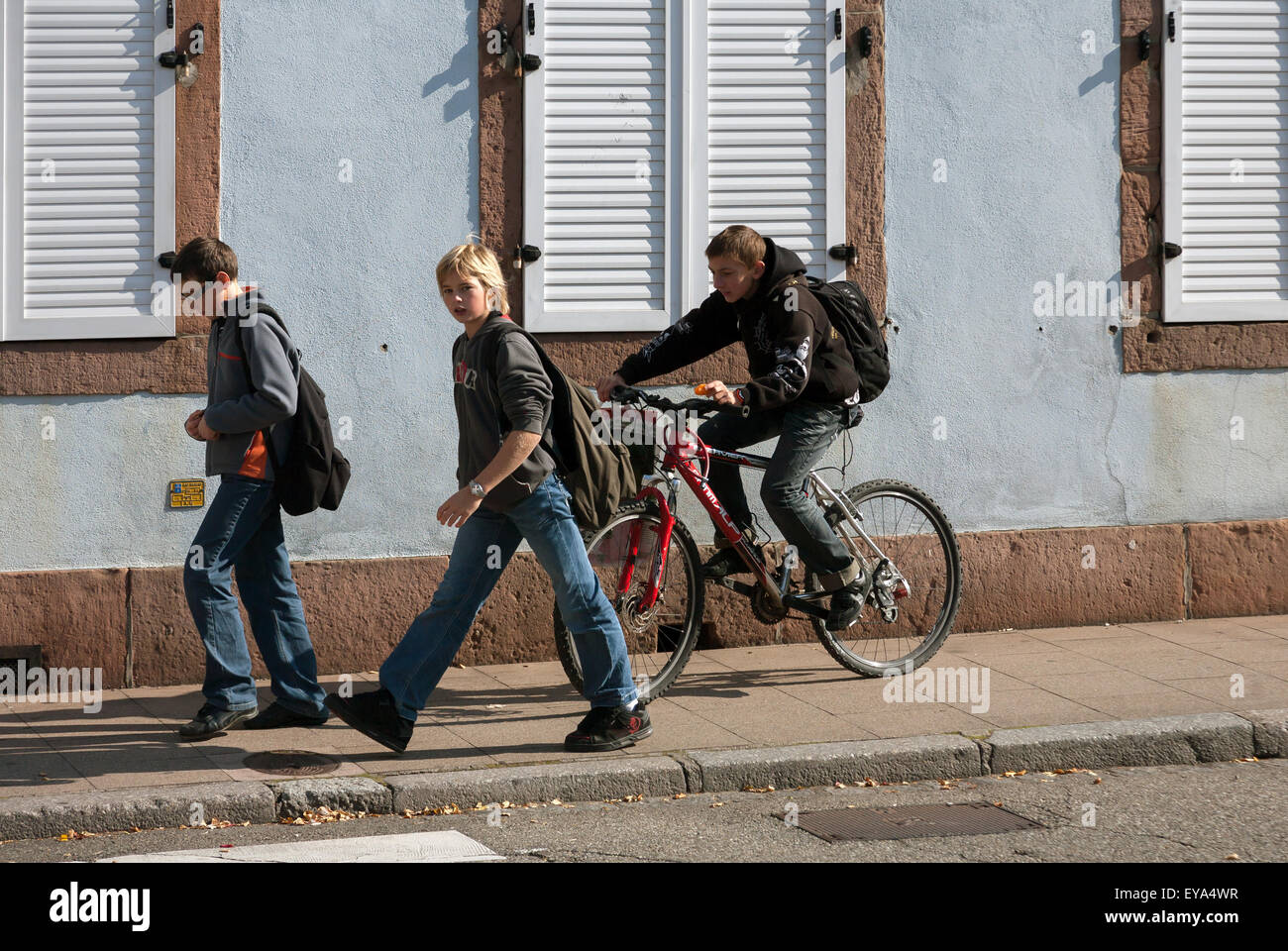 Markirch, France, schoolchildren on their way home - Stock Image