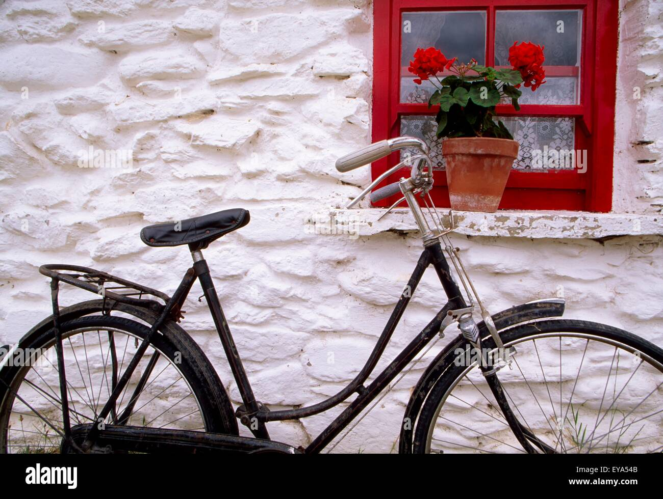 Bunratty Folk Park, County Clare, Ireland; Cottage Window And Bicycle - Stock Image