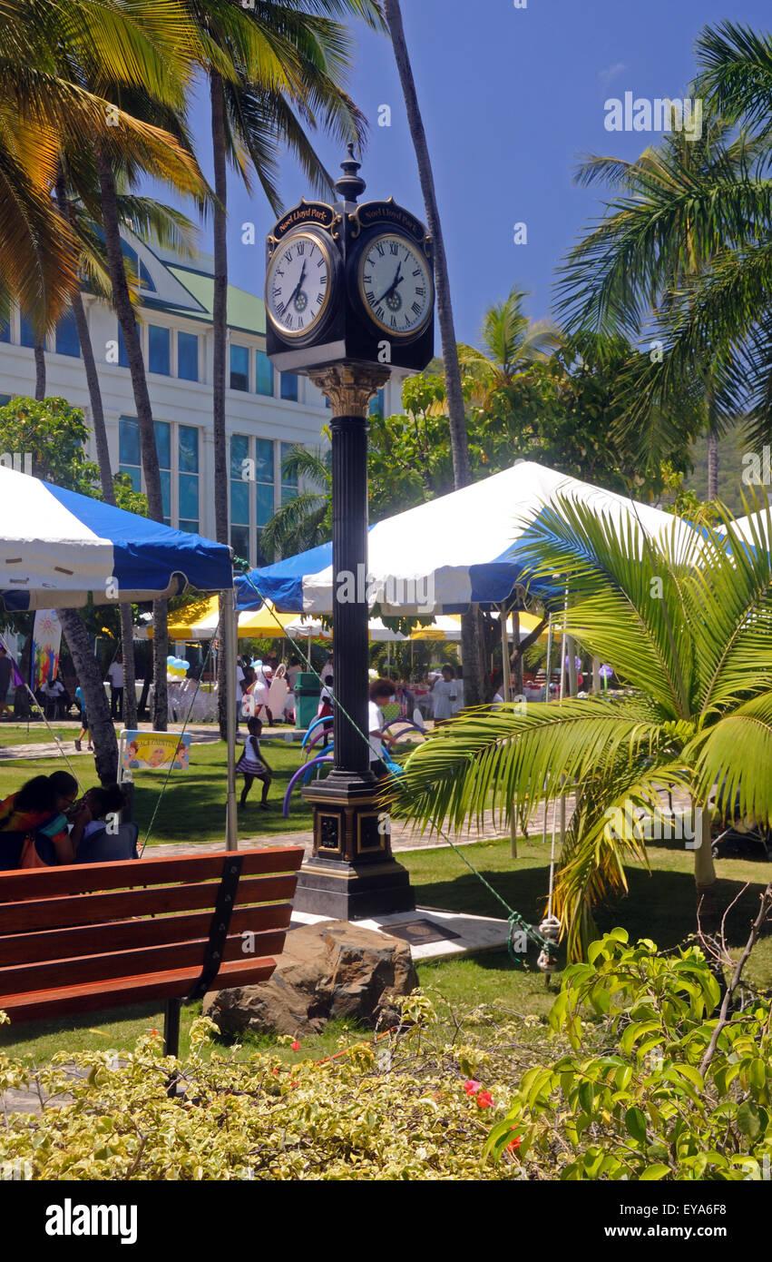The clock in The Noel Lloyd / Positive Action Movement Park in Road Town, Tortola, Virgin Islands - Stock Image
