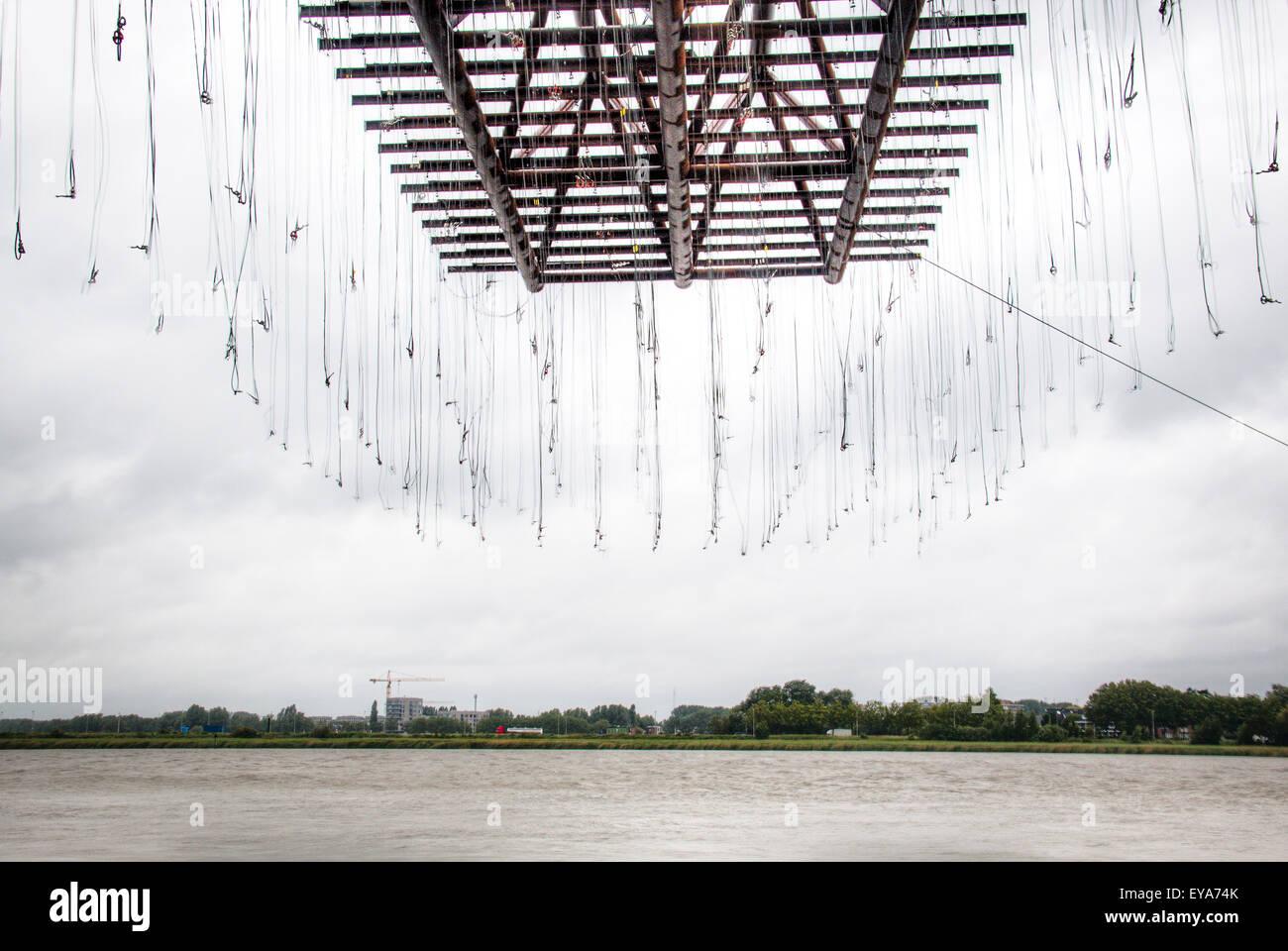 Crane at the Schelde river in Antwerp, Belgium - Stock Image