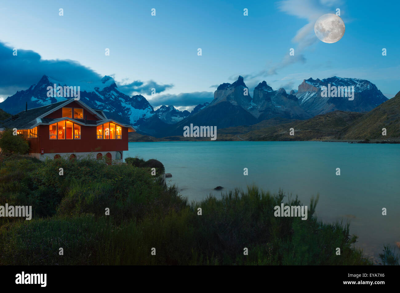 Moon rising over Lago Pehoe and Hosteria Pehoe, Torres del Paine National Park, Chilean Patagonia, Chile - Stock Image