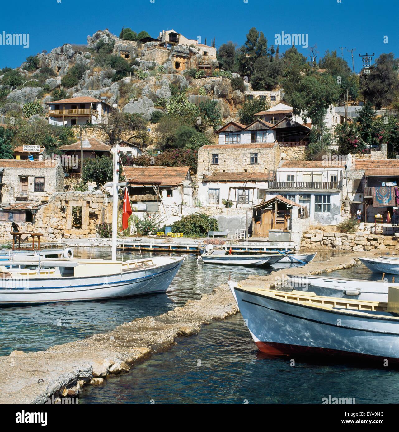 Boats In Kalekoy Harbor,Tourquoise Coast,Turkey - Stock Image