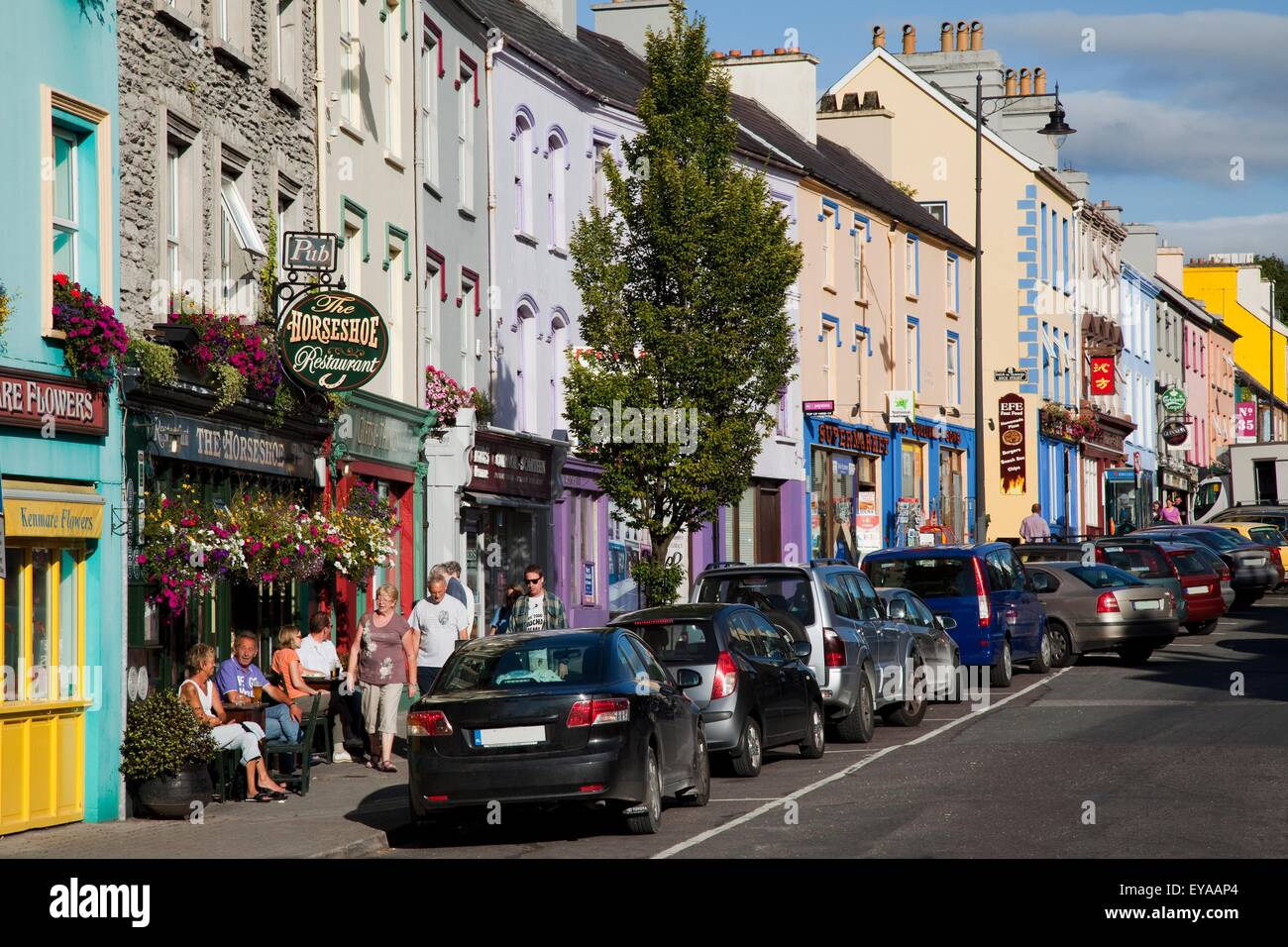 Cars Parked Along A Busy Street; Kenmare, County Kerry, Ireland - Stock Image