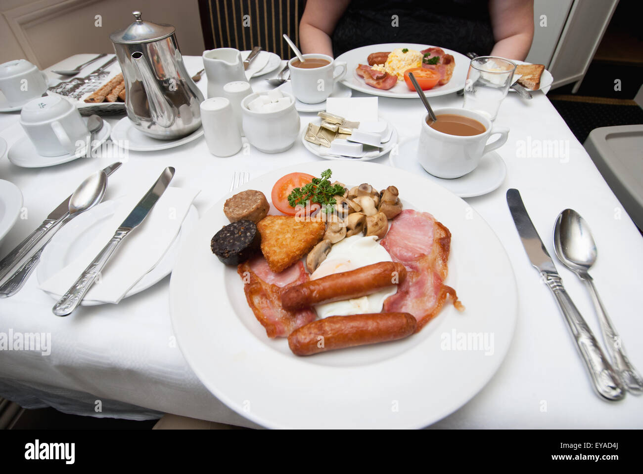 Breakfast Served On White Plates At A Table; Ireland - Stock Image