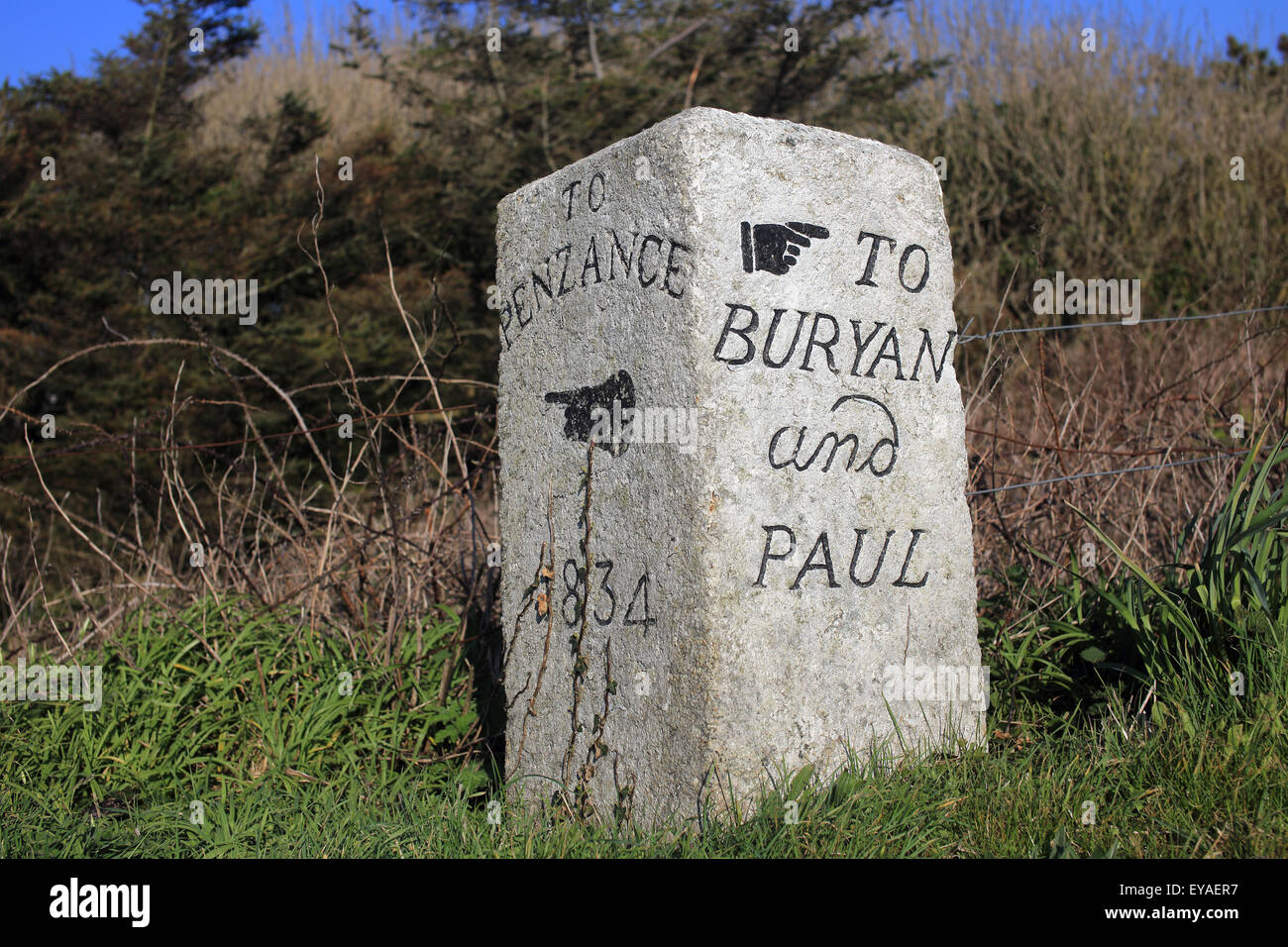 An old milestone dated 1834, 'To Penzance' and 'To Buryan and Paul', Sennen, Cornwall, England, - Stock Image